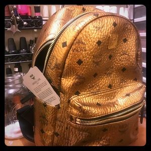 Authintic mcm gold back pack